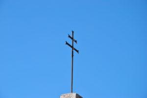 Castel di Guido segni particolari e di riconoscimentoCroce tetto chiesa